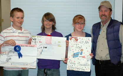 6th grade winners (Colter Bell, Dalton Brening and Josi Barbour) with Doug Ramsey, construction coordinator at Dry Fork Station