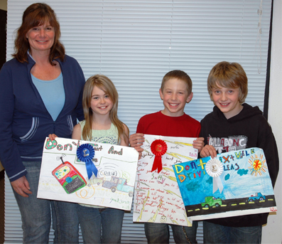 4th grade winners (Alix Barbula, Kevin Sisti and Nate Holder) with Julie Manville-Bell