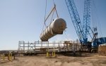 Phenosolvan vessel lifted, ready to be set on its foundation at Great Plains Synfuels Plant.