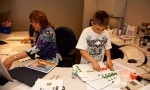 Vickie Volk, human resources assistant, put her son Jonathan to work on mailings.