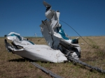 Mangled boat tangled in transmission line conductor