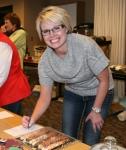 Jennifer Ehli bids on pretzels donated by Julie Ness