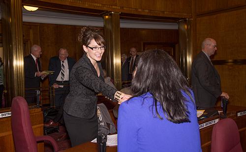 ND Sen. Jessica Unruh (left) meets colleague Sen. Nicole Poolman.