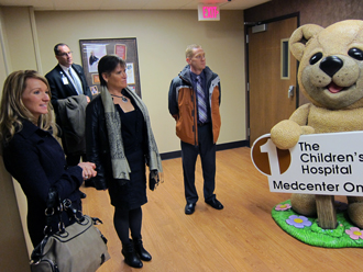 "Touring ""Amber's Dream"" within Sanford Children's Hospital in Bismarck, ND (from left): Jennifer Holen, Basin Electric; Tom Petrick, Sanford Health Foundation; Heather Kash, St. Baldrick's; and Jeremy Woeste, Basin Electric."