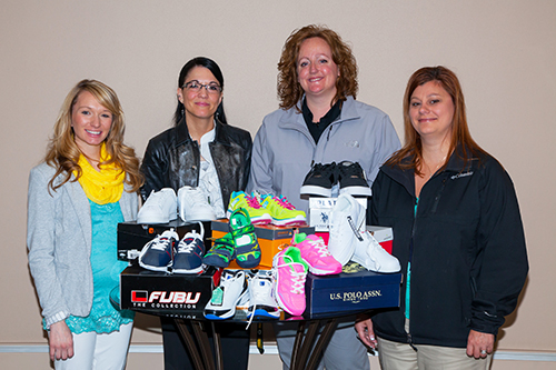 From left: Jen Holen, Basin Electric event planner and charitable giving coordinator; Carrie Grosz, Carrie's Kids; Terisina Hintz, Steep Me A Cup of Tea owner; and Jessica Kuntz, Berg's Towing. Hintz and Kuntz represent two businesses that took part in the recent shoe drive.