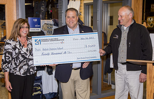 Andrew M. Serri (center), Basin Electric CEO and general manager, presents a $20,000 check to ... (waiting for names)