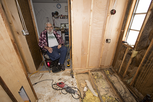 Cliff Stack sits in the entryway of his bathroom before Basin Electric helped make it accessible.