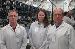 (From left) Pius Fischer, Amanda Wangler and Dave Schneider test equipment at the factory.