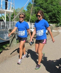 "Nicole Perreault (left) and her sister, Annie Lindseth, walked with ""Addie's Basin Buddies"" during the Cystic Fibrosis Foundation Great Strides Walk on June 15."