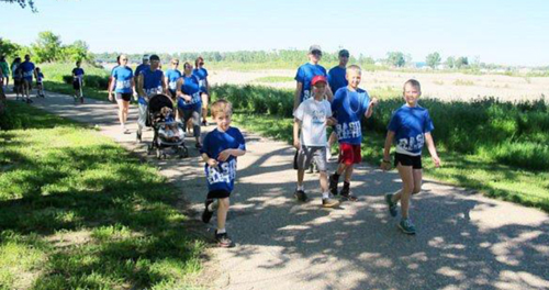 """Addie's Basin Buddies,"" a team that took part in the June 15 Cystic Fibrosis Foundation Great Strides Walk, strolls down a walking path."