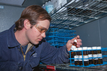 Jacob Dow, an environmental hydrologist for Dakota Gas, examines a water sample he delivered to the Dakota Gas chemistry lab on-site at the Great Plains Synfuels Plant.