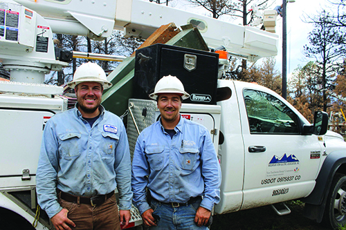 Bryce Myers (left) and David Lagge were two linemen who helped evacuate people in the path of the Black Forest Fire in Colorado this spring.