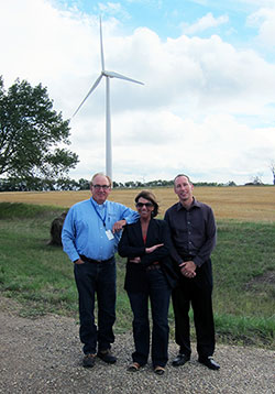 "As the vehicle pulled into the Wilton Wind farm Jo Ann Emerson (center) said, ""Wind turbines are quite handsome on the right landscape."" Guiding Emerson on the tour were Daryl Hill (left), Basin Electric manager of media and community relations, and Mike Eggl, senior vice president of Communications & Administration."