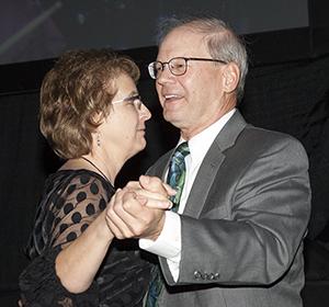Steve Tomac, senior legislative representative, dances with Vicki Zimmerman during Basin Electric's Annual Meeting banquet.