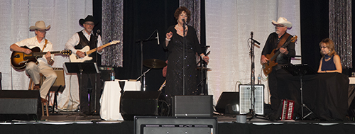 "Patsy Cline tribute band ""Cassie and the Bobs"" performs during the banquet."