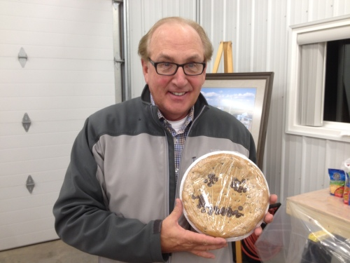 Daryl Hill shows off the gift he received from Joan Dietz at the Great Plains Synfuels Plant. A fellow member of the tours team, Dietz knew of Hill's fondness for the cookies from the Synfuels Plant cafeteria. This one was made just for him.