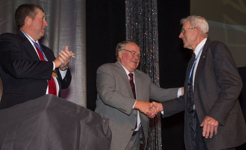 (From left) Reuben Ritthaler and Roy Ireland congratulate fellow board retiree Wayne Child at the 2013 annual meeting banquet.