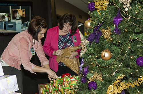 Human Resources Coordinators DesaRae Hogan (left) and Susan Vinje organize gifts.