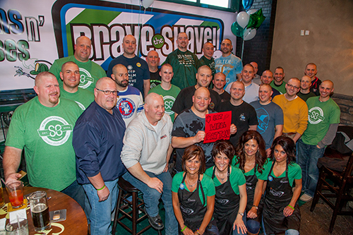 In support of the St. Baldrick's Foundation, a group of shaving heroes pose for a photo after the second Guns n' Hoses event, at Blarney Stone Pub in downtown Bismarck, ND.