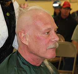Randy Scharosch first shaved his head for St. Baldrick's in 2010 after he made a bet with co-workers. Click the photo for more on that. This year marks the second year he's shaved.