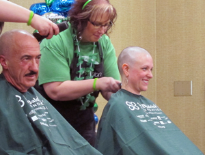 (From left) Dr. Rafael Ocejo and Dr. Melissa Seibel get their heads shaved as part of Sanford Health's Brave the Shave event.