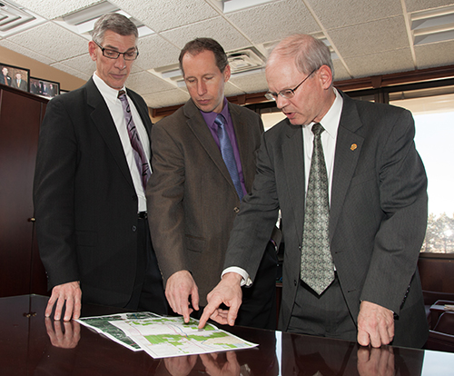 (From left): Senior Legislative Representative Dale Niezwaag, Mike Eggl, senior vice president of Communications and Administration, and Senior Legislative Representative Steve Tomac discuss North Dakota's leading role in developing an energy states coalition.