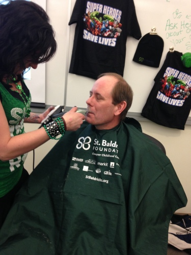 Tom Stalcup shaving off his mustache.