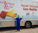 Dr. Steven Deisz stands next to the Ronald McDonald Care Mobile, which provides dental care to kids who haven't been fortunate enough to receive needed dental check-ups in their lives.