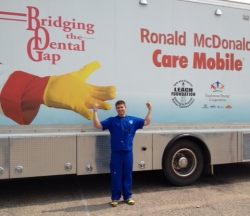 Dr. Steven Deisz stands next to the Ronald McDonald Care Mobile, which provides dental care to kids who haven't been fortunate enough to receive dental care.