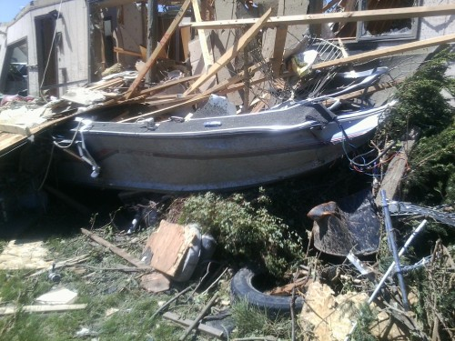 Heumiller's boat was picked up by the tornado and landed near the living room of his house.