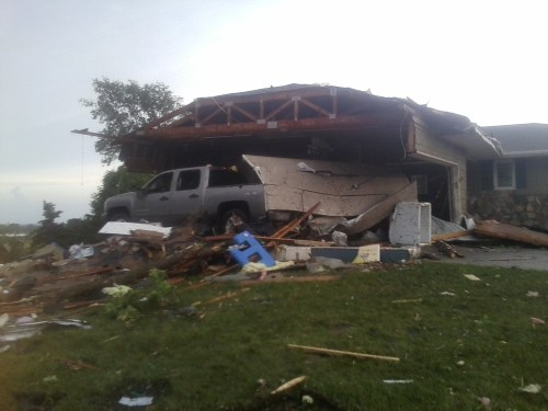 Three walls of Craig Heumiller's garage were ripped off during the June 18 tornado in Wessington Springs, SD.