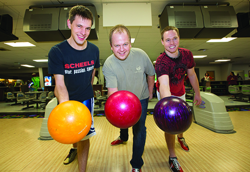 Basin Electric employees Scott Rivinius (left), James Decker and Brock Schmeets were among those who participated on Basin Electric's team for United Way Bowling Fun Day.