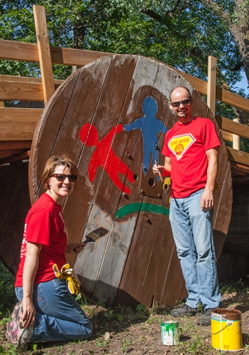 Basin Electric employees Sheila Renner, administrative assistant II, and Dean Anderson, network engineer, volunteer at Papa's Pumpkin Patch during the 2014 United Way Day of Caring.