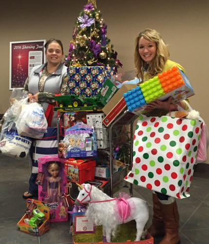 Kristine Coffey (left), mom of St. Baldrick's honoree Kali Grace, collected 30 toys donated by Basin Employees to the inaugral Kali Grace & Minnie Mouse Toy Drive. Jen Holen (right), Basin Electric's event planner and charitable giving coordinator, coordinated the effort at Basin Electric.