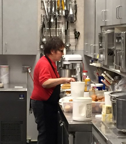 Marla Saville, food services technician, preps food for the holiday meal.