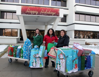 (From left) Jen Duletski, Kendra Casavant and Deb Noyes from Morton County Social Services pick up donated presents at Basin Electric Headquarters.