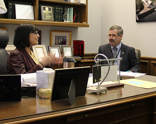 Cooperative Network's David Ward (right) talks with Sen. Terri Bonoff about cooperative issues at MN Co-op Day at the Capitol.