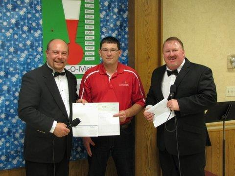 Jamie Parisien, (center) a master electrician for North Central Electric Cooperative, presents donations from North Central and Basin Electric to the Bottineau Cheerbox Telethon, part of North Central's Willie Wired Hand Christmas Giving Fund. Thisdonation is the largest single donation the Bottineau Cheerbox Telethon receives.
