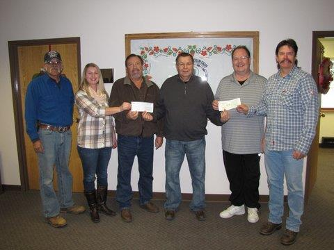 Several North Central employees present a donation to the Turtle Mountain Band of Chippewa Indians Tribal Council, as part of North Central's Willie Wired Hand Christmas Giving Fund program.