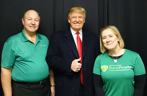 Basin Electric Director Charlie GIlbert (left) and Basin Electric Senior Staff Writer/Editor Tracie Bettenhausen (right) meet Donald Trump at a rally in Norwalk, IA.