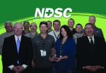 Leland Olds Station employees accepted the Lifesaver Award from North Dakota Safety Council (NDSC) representatives Feb. 4. (Front row, from left) Chuck Clairmont, NDSC executive director/CEO; Murray Snyder, first response team; Amanda Huntimer, first response team; and Darrel Hellman, NDSC board president. (Middle row, from left) Myles Hafner, first response team; James Porter, first response team; Kris Schmidt, first response team; and Jake Schmidt, first response team. (Back row, from left) Monte Sailer, first response team; Devin Renner, Leland Olds Station operator; Kasey Lesmann, first response team; and Todd Isaak, first response team. Not pictured: Tracy Johnson, Leland Olds Station operator; and Michelle Tipton, Straight from the Heart AED trainer.