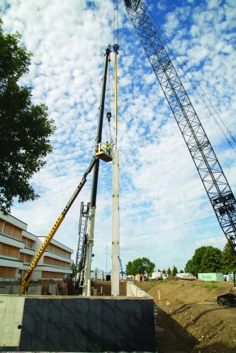 A milestone was reached in mid-July when the contractors began placing 60-foot-tall columns for the pre-cast walls of the West Building.