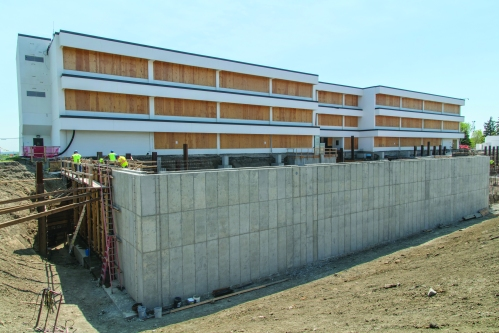 In May, contractors poured the north and northwest cement walls of the West Building basement. The total amount of concrete used for various pours ranged from 65 to 95 yards of concrete, and each concrete pour took several days to set.