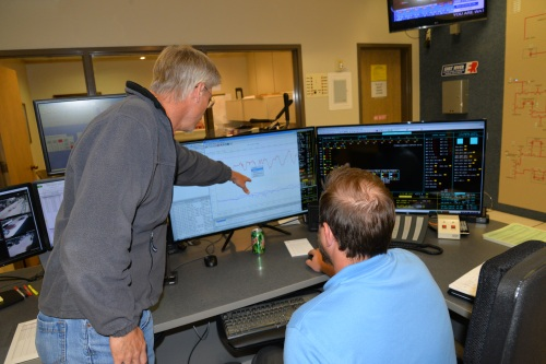 Jeff Rud, East River power supply specialist, monitors loads to determine when to activate the cooperative's load control system, which sheds member loads to keep peak demand as low as possible.