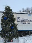 From now until Christmas, this 12-foot-tall Christmas tree will hang from a crane 238 feet in the air at Basin Electric's headquarters building in Bismarck.