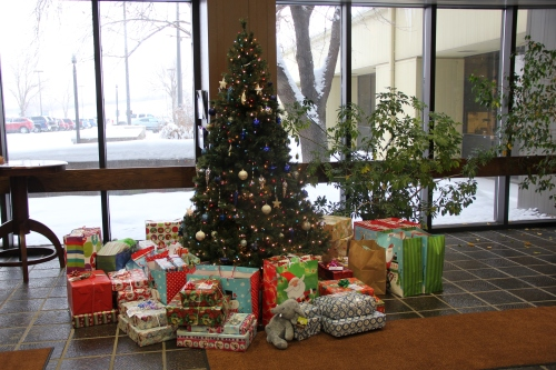 This Sharing Tree, located in the lobby of the Great Plains Synfuels Plant is surrounded by 50 gifts employees purchased for underprivileged children in Mercer County.