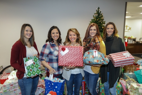 Basin Electric Headquarters employees Sarah Erickson, Jackie Fleck, Jen Holen, Jen Kringstad, and Lindsay Kostelecky gather gifts to deliver to partner agencies.