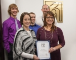 "Joann Lozensky, representing North Dakota Young Professionals, presents the 2016 ""Best Place to Work"" runner up award to Shawna  Piatz, Basin Electric manager of benefits plans. In the back are three Basin Electric employees who are involved in the Bismarck-Mandan Young Professionals Network."