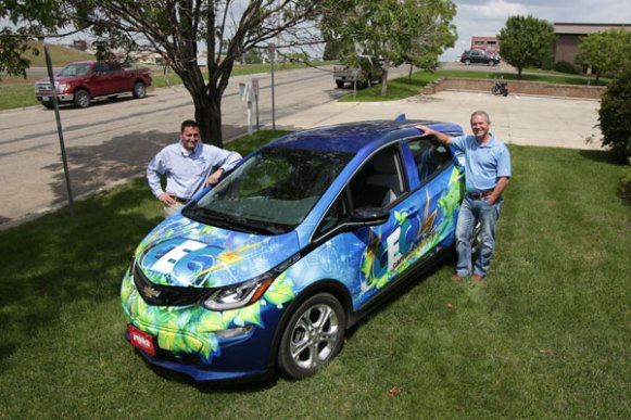 Capital Electric staff with Elektra, their Chevrolet Bolt.