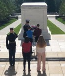 Peterson (right) places wreath on Tomb of the Unknown Soldier.